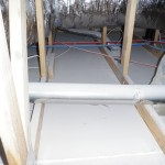 A new construction home missing insulation in the attic.
